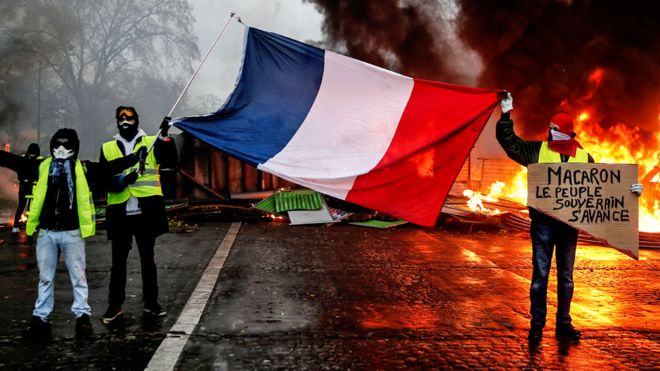 France to suspend fuel tax hikes after 'gilets jaunes' protests