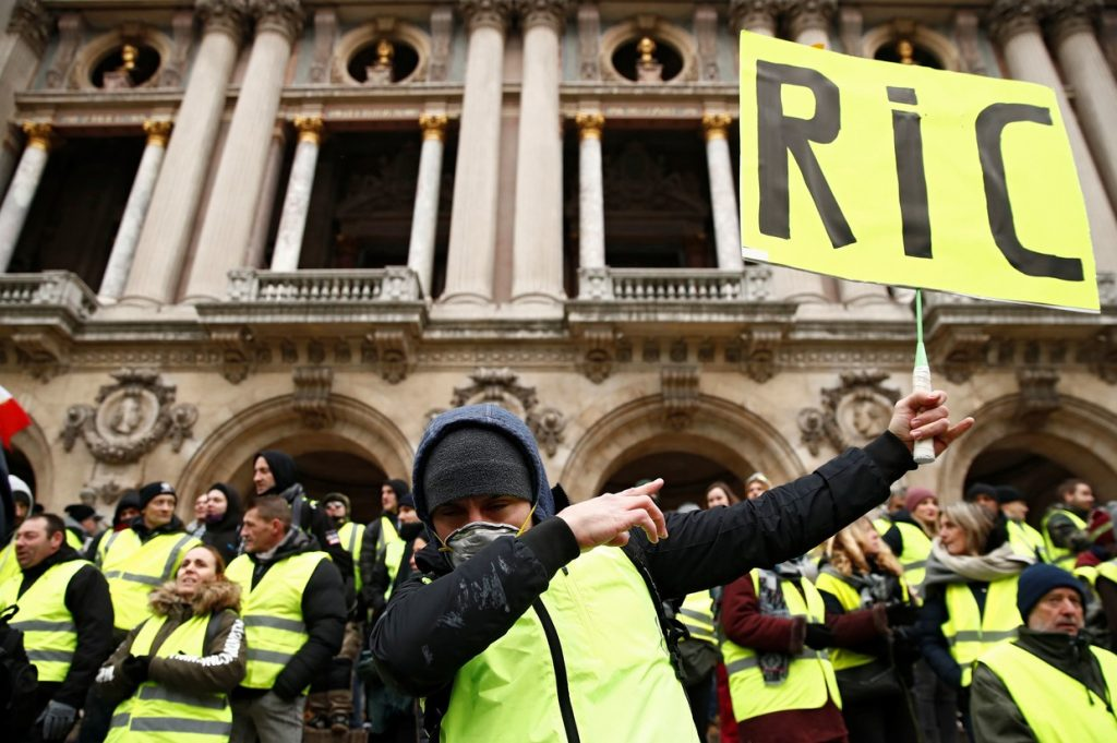 Today's Protesters march in Paris demanding Macron resign