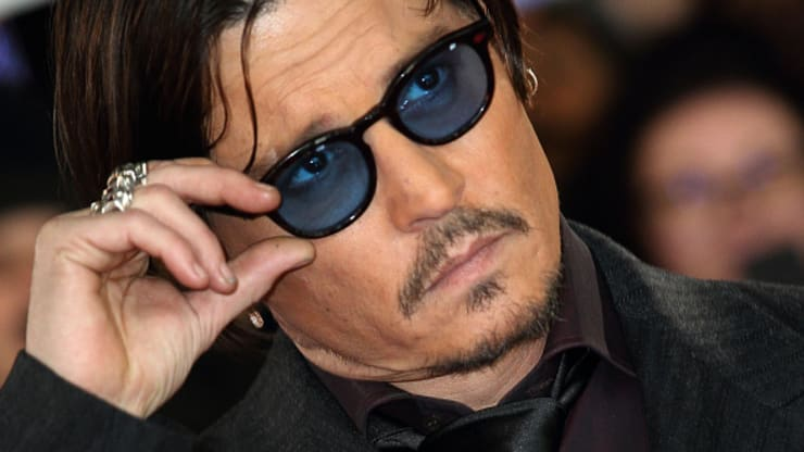 Actor Johnny Depp loses 'wife beater' libel case in London