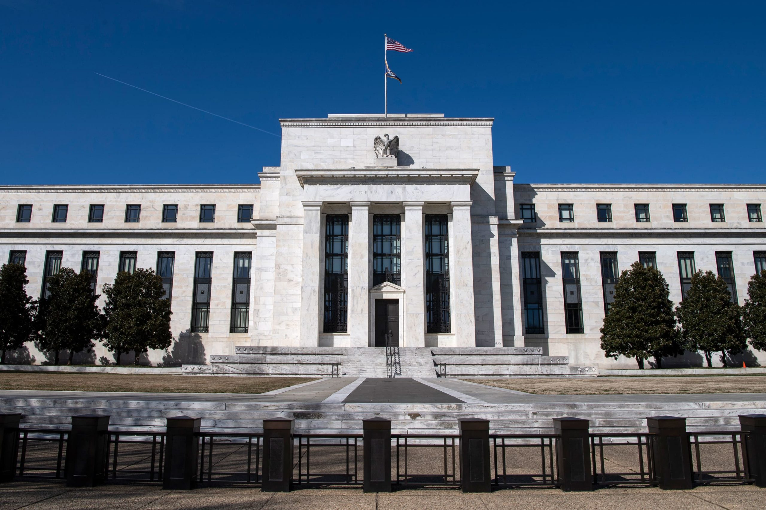 Fed officials say easy policy will stay in place until economic 'outcomes' are achieved